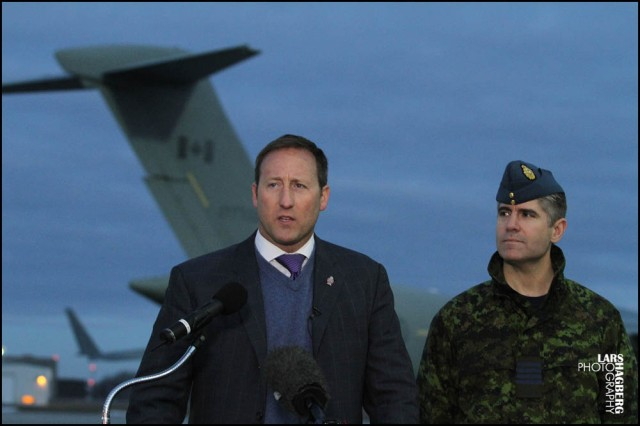 Minister of Defence Peter MacKay and CFB Trenton Commanding Offcier Col. Sean Friday speaks during a news  conference at CFB Trenton, in Trenton, Ont., on Tuesday Jan. 15, 2013. MAcKay announced that Canada is sending a C-17 Globemaster to help France with the conflict in Mali. THE CANADIAN PRESS/Lars Hagberg