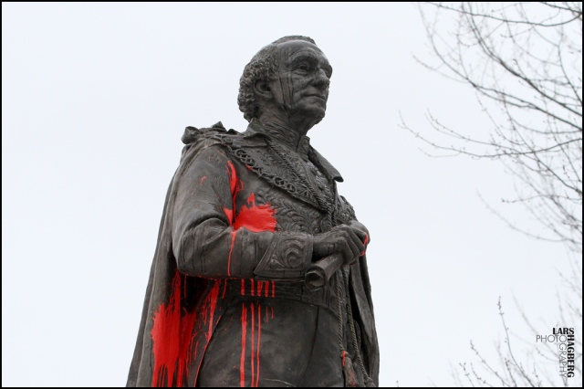 The statue of Canada's first Prime Minister, Sir John A. MacDonald, has paint on it after vandals throw paint and graffitied it, in City Park in Kingston, Ont., on Friday Jan., 11, 2013. THE CANADIAN PRESS/Lars Hagberg