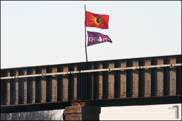 Mohawk warrior flag and Six Nations purple native flag fly over the CN and the CP train tracks crossing in Tyendinaga, Ont., on Wednesday Jan. 16, 2013. Mohawk warriors block the train tracks in support for the Idle No More movement during the National Day of Protest. THE CANADIAN PRESS/Lars Hagberg