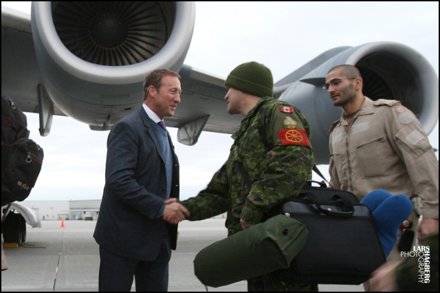 Minister of Defence Peter MacKay shake hands with Canadian forces members of Squadron 429 at CFB Trenton, in Trenton, Ont., on Tuesday Jan. 15, 2013. Canada is sending a C-17 Globemaster to help France with the conflict in Mali. THE CANADIAN PRESS/Lars Hagberg