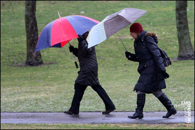 Two women walk in a park during some freezing rain in Kingston, Ontario on  April 12, 2013. THE CANADIAN PRESS IMAGES/Lars Hagberg