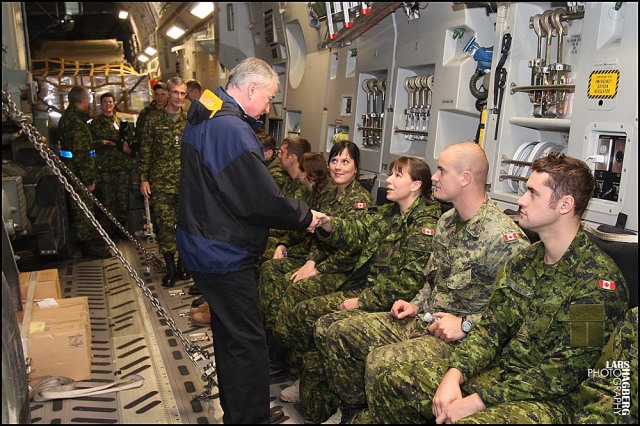 Minister of Defence Rob Nicholson, shakes hands with Canadian soldiers onboard a C-17 Globemaster before their depature at CFB Trenton in Trenton, Ont., on Friday Nov. 15, 2013. Canada is sending troops and medical personal to help out with the typhoon Haiyan, hit area of Philippines. THE CANADIAN PRESS/Lars Hagberg