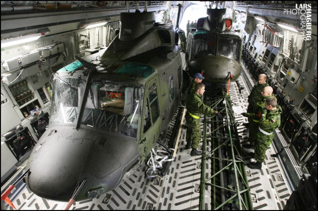 Two CH-146 Griffon helicopters from Canadian Forces Base Bagotville, sit inside a C-17 Globemaster airplane, at Canadian Forces Base Trenton in Trenton, Ont., on Sunday Nov. 17, 2013. The helicopters are bound for the typhoon Haiyan hit ara of the Philippines to support the Disaster Assistance Response Team (DART) humanitarian relief mission. THE CANADIAN PRESS/Lars Hagberg