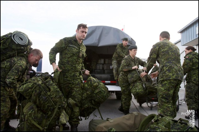 Canadian forces members from CFB Petawawa unload their gear at the passenger teerminal at CFB Trenton in Trenton, Ont., on Friday Nov. 15, 2013. Canada is sending troops  and medical personal to help out with the typhoon Haiyan, hit area of Philippines. THE CANADIAN PRESS/Lars Hagberg