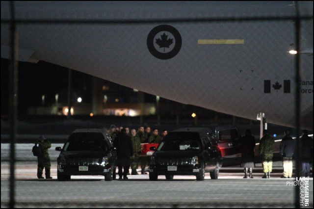 The body of Peter McSheffrey from Ottawa, is returned back to Canada at CFB Trenton in Trenton, Ont., on Wednesday on Jan. 22, 2014. Peter McSheffrey and Martin Glazer was killed when a bomb went off in Kabul on Jan. 17.