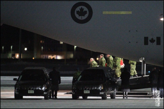 The body of Martin Glazer from Gatineau, Que., is returned back to Canada in a flag draped coffin, at CFB Trenton in Trenton, Ont., on Wednesday on Jan. 22, 2014. Peter McSheffrey and Martin Glazer was killed when a bomb went off in Kabul on Jan. 17.