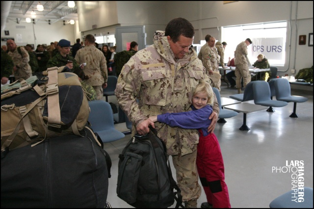 Dylan Taylor, 6 years old, from Curtis, Ont., hugs her uncle Warrant Officer Adam Taylor at the arrival gate at CFB Trenton in Trenton, Ont., on Thursday on Jan. 23, 2014. Around hundred Canadian tropps arrived back from Afghanistan, this is one of the last batched of troops returing home. Lars Hagberg for the Globe and Mail