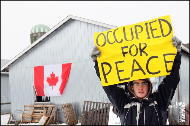 Dean Tea holds a sign during the Frank Meyers farm protest in Quinte West, Ontario, on Tuesday3 on January 14, 2014. Frank Meyers farm land has been expropriation by the Department of National Defence. Meyers signed an agreement but says he was was given the choice.  Lars Hagberg for the Globe and Mail