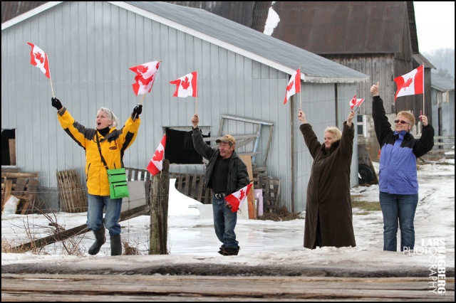 Protesters wave flags to passing trains during the farm protest in Quinte West, Ontario, on Tuesdayon January 14, 2014. Farmer Frank Meyers signed an expropriation agreement with the Department of National Defence but says he was never given a choice. The land that the farm sits on will be used for the JTF2 new training facility based out of CFB Trenton.  Lars Hagberg for the Globe and Mail