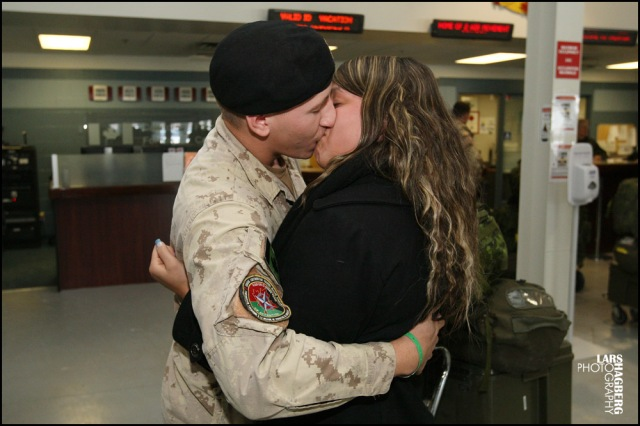Cpl. Anthony Jacques kisses his girlfriend, Catherine Berthiaume, from Montreal, Que., at the arriva gate at CFB Trenton in Trenton, Ont., on Thursday on Jan. 23, 2014. Around hundred Canadian troops returned from serving several months in Afghanistan. Lars Hagberg for the Globe and Mail