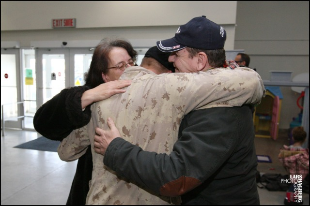 Cpl. Anthony Jacques hugs his mum, Lin and dad, Daniel Jacques from Montreal, Que., at the arrival gate at CFB Trenton in Trenton, Ont., on Thursday on Jan. 23, 2014. Around hundred Canadian troops returned from serving several months in Afghanistan. Lars Hagberg for the Globe and Mail