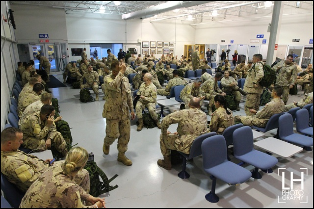 Canadian forces members sit in the waiting lounge at Canadian Forces Base Trenton before take-off, in Trenton, Ont., on Thursday, Oct. 16, 2014. The forces is responsible for initiating preparations for the Canadian forces units that will deploy in Operation IMPACT in Kuwait and help fight ISIL. THE CANADIAN PRESS/Lars Hagberg
