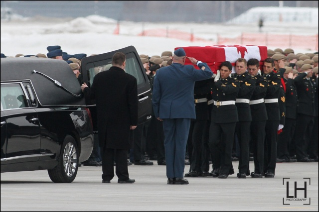 Military pallbearers from the Canadian Special Operations Forces Command carry the flag draped casket with the body of Sgt. Andrew Joseph Doiron at Canadian Forces Base Trenton in Trenton, Ont., on Tuesday March 10, 2015. Sgt. Doiron was killed by friendly fire during operation Impact on March 6, in northern Iraq. Doiron was a member of Canadian Special Operations Regiment, based at Garrison Petawawa, Ontario. Doiron's death is the first casualty for Canada during the mission in Iraq.  Lars Hagberg/THE CANADIAN PRESS