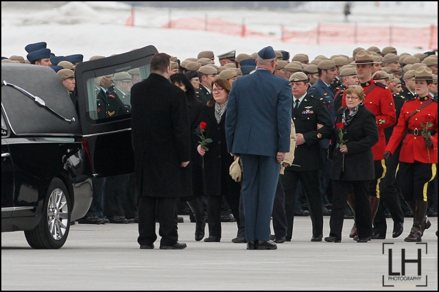 A family members to Sgt. Andrew Joseph Doiron hold flowers as the view his casket at Canadian Forces Base Trenton in Trenton, Ont., on Tuesday March 10, 2015. Sgt. Doiron was killed by friendly fire during operation Impact on March 6, in northern Iraq. Doiron was a member of Canadian Special Operations Regiment, based at Garrison Petawawa, Ontario. Doiron's death is the first casualty for Canada during the mission in Iraq.  Lars Hagberg/THE CANADIAN PRESS